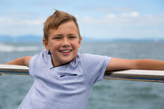 Smiling boy on the sea Royalty Free Stock Image