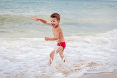 Smiling boy on the sea Royalty Free Stock Photos