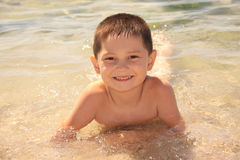 Smiling boy on seashore Royalty Free Stock Photo