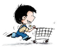 Smiling Boy Shopper running with Shopping Cart Royalty Free Stock Photography