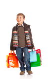 Smiling boy with shopping bags Royalty Free Stock Photo