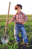 Smiling boy with shovel Royalty Free Stock Photography