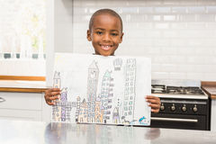 Smiling boy showing his drawing Stock Images