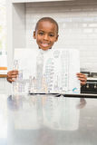 Smiling boy showing his drawing Stock Image