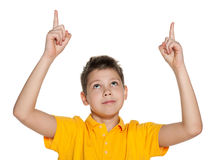 Smiling boy showing his fingers up Royalty Free Stock Images