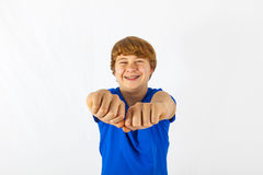 Smiling boy is showing his fist Stock Photo