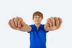Smiling boy is showing his fists Stock Images