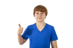 Smiling boy is showing his thumb up; isolated on the white bac Royalty Free Stock Photos