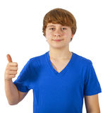 Smiling boy is showing his thumb up; isolated on the white bac Royalty Free Stock Image