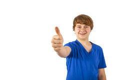 Smiling boy is showing his thumb up; isolated on the white bac Stock Photos
