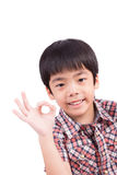 Smiling boy showing ok sign Royalty Free Stock Images