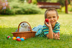 Smiling boy showing an red easter egg Royalty Free Stock Photography