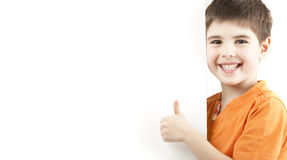 Smiling boy showing thumb. Image of a smiling boy showing thumb Royalty Free Stock Photography