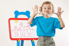 Smiling boy shows family painted on a whiteboard Stock Image