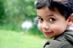 Smiling boy by side of lake Royalty Free Stock Photo