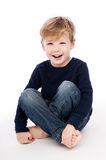Smiling Boy Sitting in Casual Cloths Stock Photo