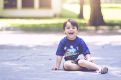 Smiling boy. Sitting on the floor Stock Photo