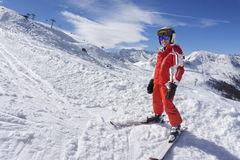 Smiling boy in ski suit on the snow Royalty Free Stock Photos