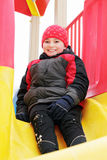 Smiling boy in slide Royalty Free Stock Photo