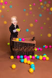 Smiling boy with small balls Royalty Free Stock Photo