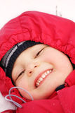Smiling boy on snow Stock Images