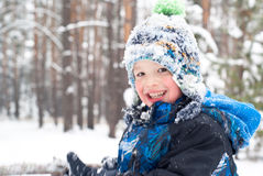 Smiling boy in the snow outdoor Stock Photography