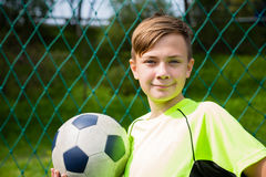 Smiling boy soccer player Stock Photos