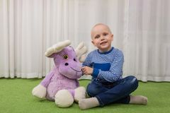 Boy with a soft toy royalty free stock image