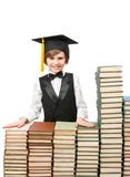 Smiling boy at stacks of old books Stock Photography