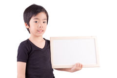 Smiling boy standing with empty horizontal blank in hands Royalty Free Stock Photos