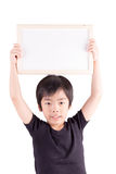 Smiling boy standing with empty horizontal blank in hands Royalty Free Stock Image