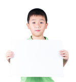 Smiling boy standing with empty horizontal blank paper in hands isolated on white background Stock Images
