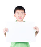 Smiling boy standing with empty horizontal blank paper in hands isolated on white background Stock Photo