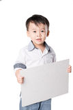 Smiling boy standing with empty horizontal blank paper in hands isolated on white background Royalty Free Stock Images