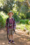 Smiling boy standing in the forest Stock Photo