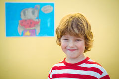 Smiling boy standing in front of the camera Stock Photos