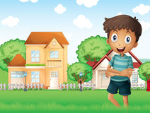 A smiling boy standing in front of the neighborhood Royalty Free Stock Images