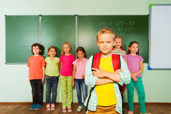 Smiling boy stands in front near blackboard Royalty Free Stock Photos