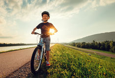 Smiling boy starts to ride a bicycle Royalty Free Stock Photo