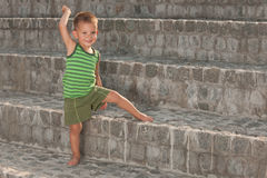 Smiling boy on the stone steps Royalty Free Stock Image
