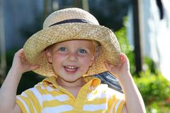Smiling boy with straw hat Royalty Free Stock Image