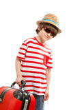 Smiling boy in a straw hat with a luggage Royalty Free Stock Images