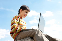Smiling boy studies outside Stock Image
