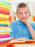 Smiling boy studying Royalty Free Stock Photos
