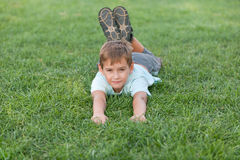 Smiling boy on the summer meadow Royalty Free Stock Photos