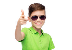 Smiling boy in sunglasses and green polo t-shirt Royalty Free Stock Image