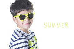Smiling boy with sunglasses. On a white background Royalty Free Stock Images