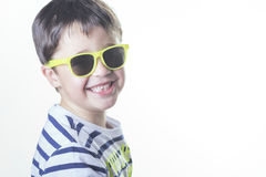 Smiling boy with sunglasses. On a white background Royalty Free Stock Photography