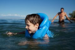 Smiling boy swimming stock photography