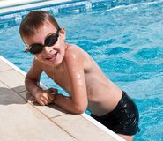 Smiling boy at swimming pool royalty free stock image